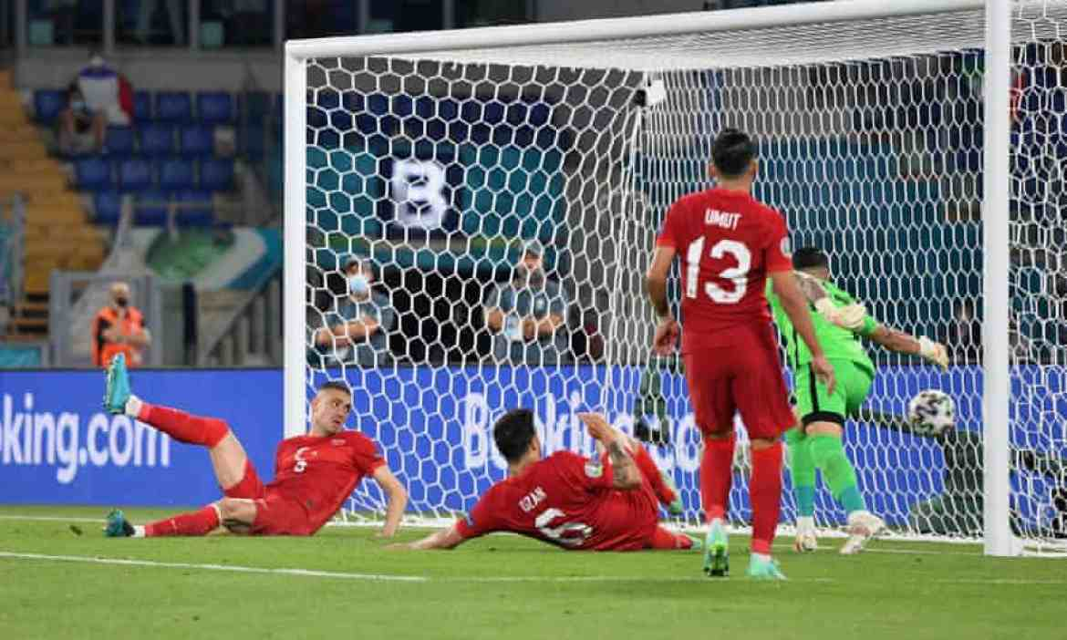 Turkey's Merih Demiral scores the own goal that gave Italy the lead
