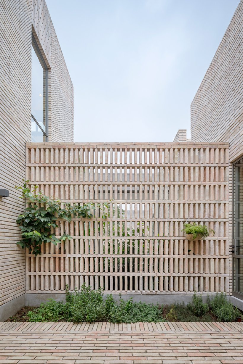 asps white clay brick residence revolves around interior courtyards in mexico city 7