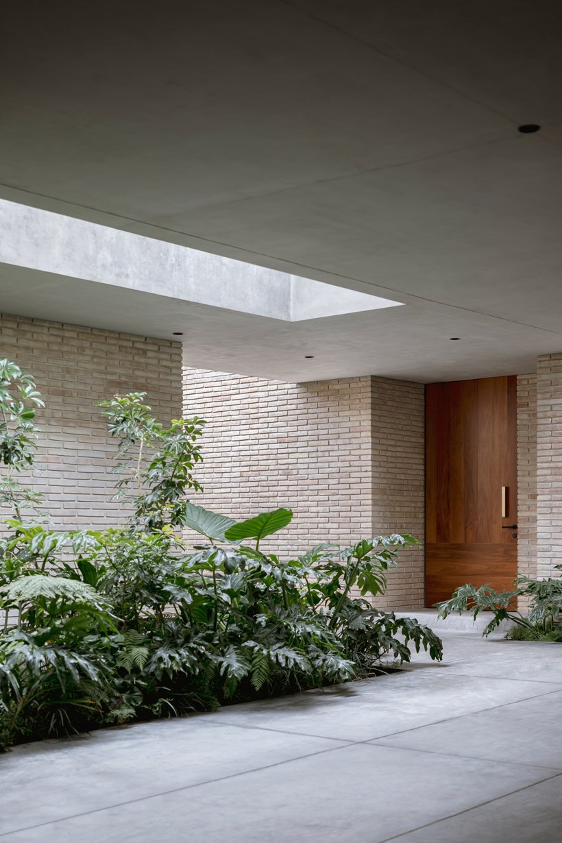 asps white clay brick residence revolves around interior courtyards in mexico city 11