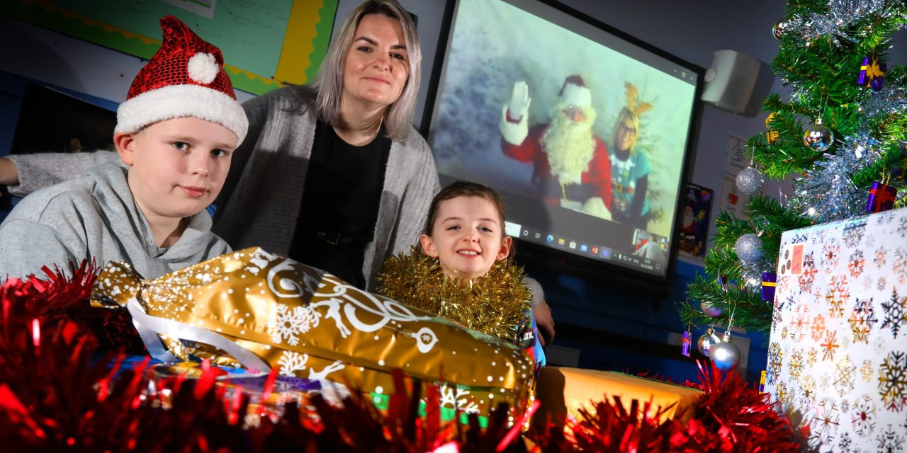Santa Claus uses the power of technology to spread festive cheer to school pupils