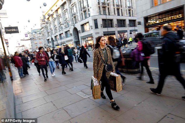 It may feel like Christmas on busy pavements but high street footfall is down four per cent
