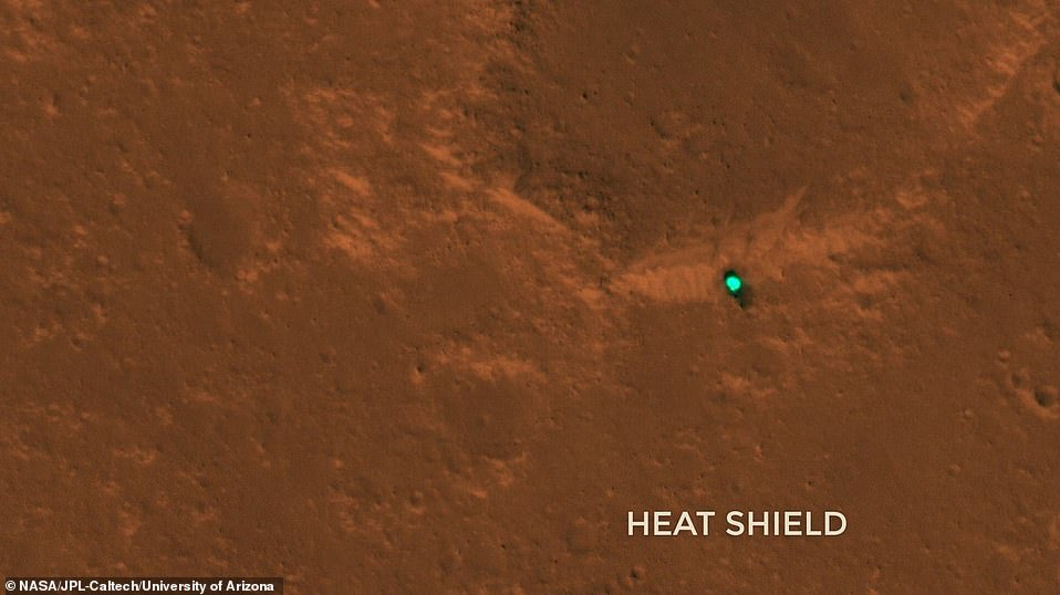 In the images released today by NASA, InSight and its parts appear as bright teal specks on rust-colored landscape. But in reality, this is only a trick of the light