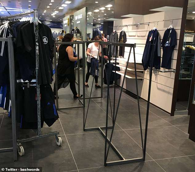 Empty clothing rails in a House of Fraser branch.Sports Direct boss Mike Ashley promised to turn the store into 'the Harrods of the high street' when he bought the chain for £90m