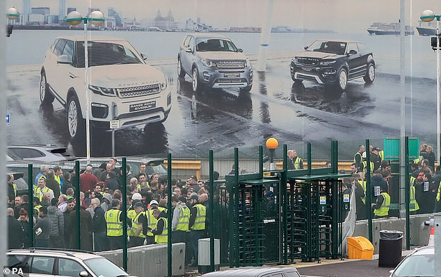 Staff gather outside the Jaguar Land Rover site in Halewood, Knowsley, on Merseyside in September