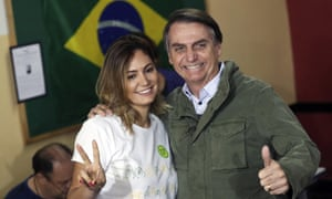 Jair Bolsonaro with his wife Michelle at a Rio polling station in October 2018.