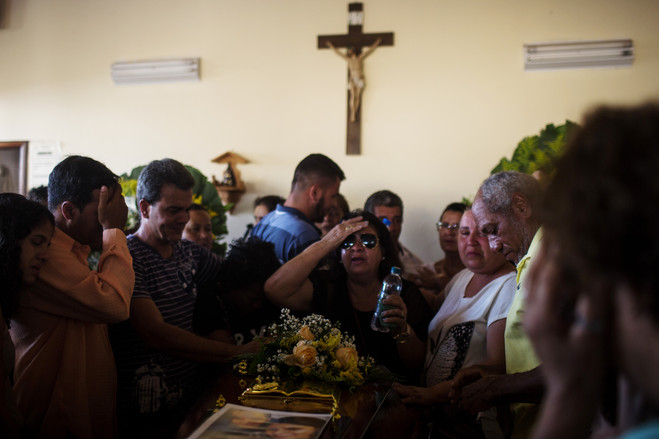 Relatives and friends attend the burial service last month of a person killed in the rupture of Dam 1 in Brumadinho, Minas Gerais, Brazil.