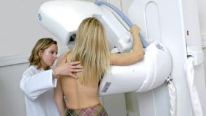 Generic picture of a woman receiving a mammogram