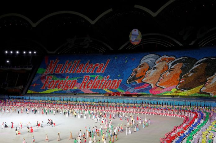 © Reuters. FILE PHOTO: Participants form a message during Mass Games in May Day stadium marking the 70th anniversary of North Korea's foundation in Pyongyang