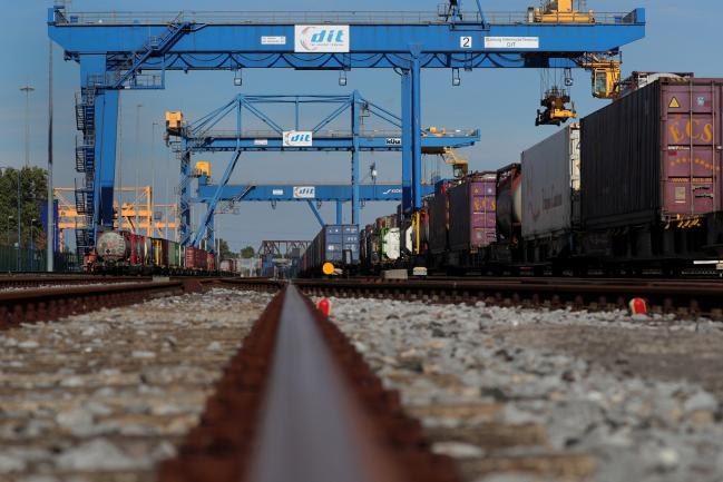 &copy Bloomberg. Shipping containers stand on wagons at the railway terminal railyard at Duisport shipping port in Duisburg, Germany, on Tuesday, Sept. 11, 2018. The trade route known in Beijing as the Belt and Road Initiative is spurring $1 trillion of investment on rail, highways and ports linking Europe and Asia.