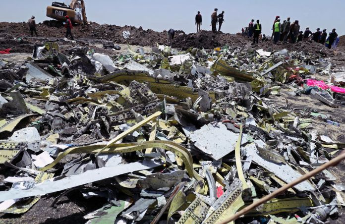 © Reuters. Wreckage is seen at the site of the Ethiopian Airlines Flight ET 302 plane crash near Bishoftu
