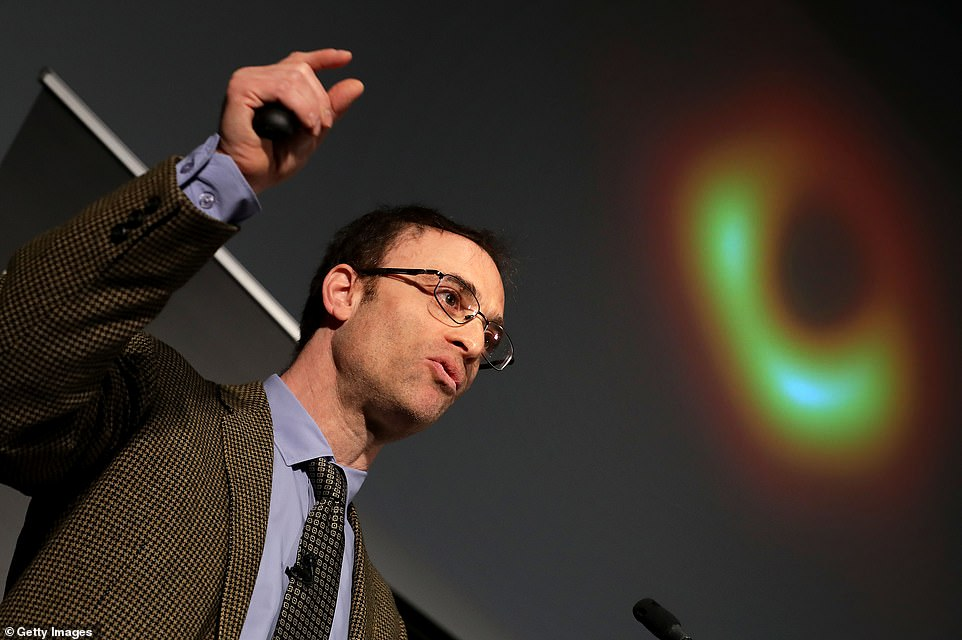 'We now have visual evidence for a black hole,' EHT Director Sheperd Doeleman said. 'We now know that a black hole exists at the center of M87. Material moving around the black hole is moving at light speeds.' Doeleman is shown above beside the groundbreaking image during the live event