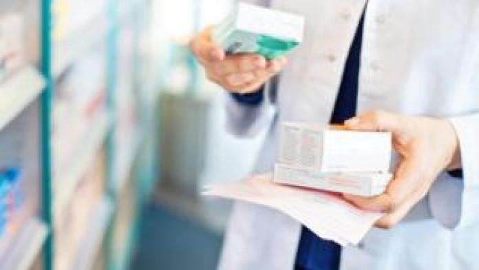 pharmacist with drugs