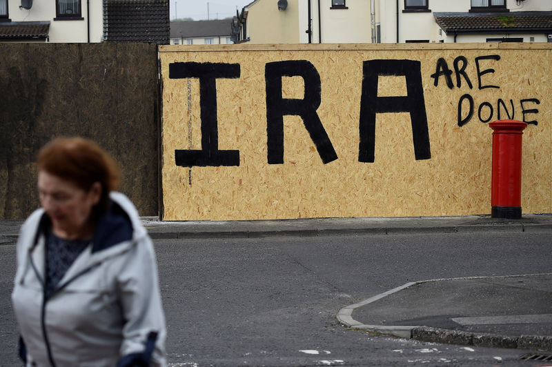 © Reuters. FILE PHOTO: IRA graffiti painted over with a message declaring it a defeated army in the aftermath of the killing of 29-year-old journalist Lyra McKee is pictured in Londonderry
