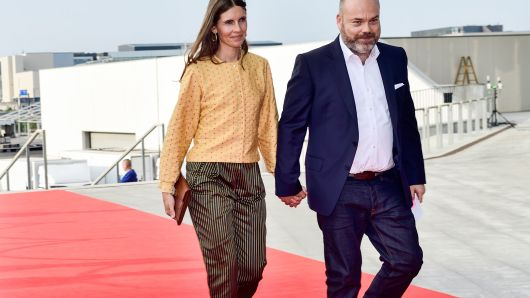 This picture taken on May 27, 2018 shows Bestseller-owner Anders Holch Povlsen and his wife Anne Holch Povlsen as they arrive at the celebration of the 50th birthday of Crown Prince Frederik of Denmark in Royal Arena in Copenhagen, Denmark.