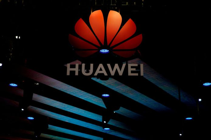 © Reuters. Huawei logo is pictured during the media day for the Shanghai auto show in Shanghai