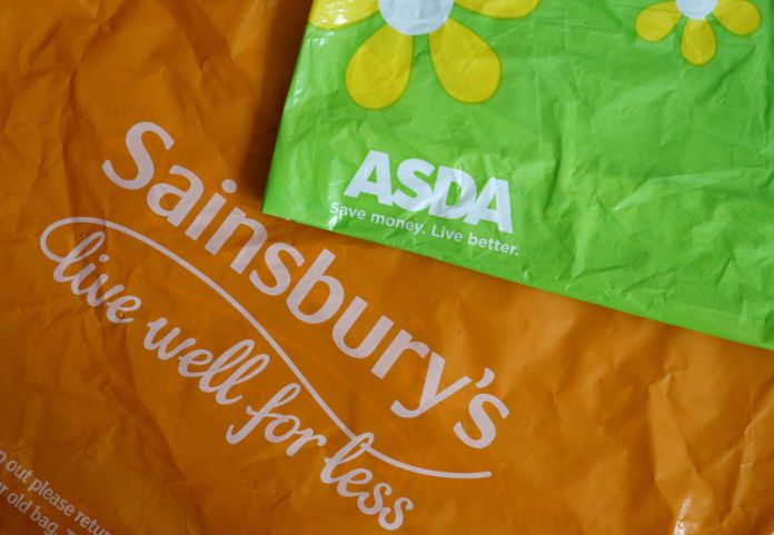 © Reuters. FILE PHOTO: Shopping bags from Asda and Sainsbury's are seen in Manchester.