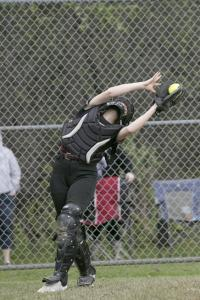 Groton-Dunstable catcher Cassidy Heulings makes a nice catch behind home plate during a softball game at Oakmont Regional.