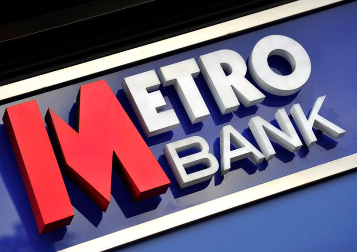 © Reuters. FILE PHOTO: A logo is seen on the outside of a branch of Metro Bank in central London