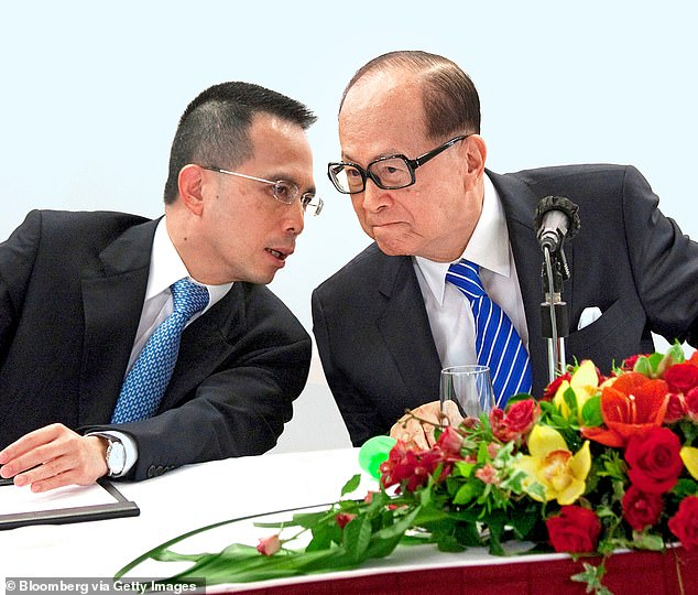 Power brokers: Head of the empire Victor Li, left, with his father Li Ka-shing