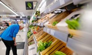 Man in Waitrose looking at vegetables