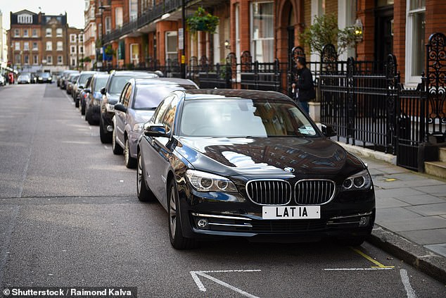 A black BMW 7 Series parked outside the Latvian embassy in London