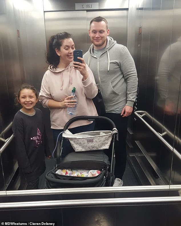 Mr Delaney, his wife and their daughter Aila are pictured in an elevator