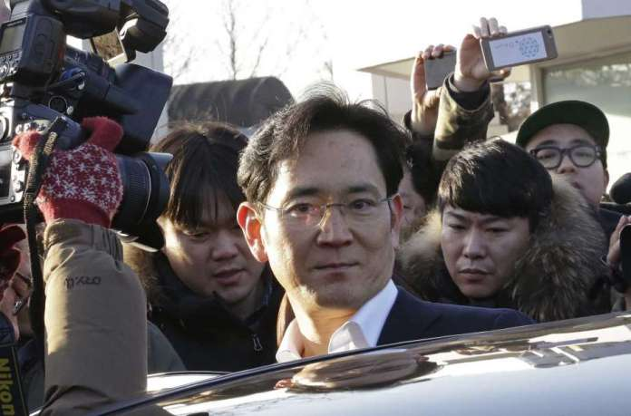 FILE - In this Feb. 5, 2018, file photo, Lee Jae-yong, vice chairman of Samsung Electronics, gets into a car to leaves a detention center in Uiwang, South Korea. Lee on Sunday, June 2, 2019, has vowed to keep up robust investments in key businesses as South Korea's leading company weathers slowing demand and the impact of trade clashes between Washington and Beijing. (AP Photo/Ahn Young-joon, File) Photo: Ahn Young-joon / Copyright 2018 The Associated Press. All rights reserved.
