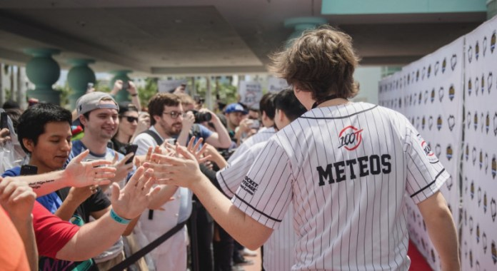 Members of 100 Thieves League of Legends esports team greet fans.