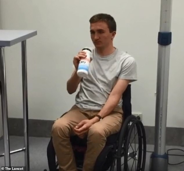 One patient, whose name is unknown, is seen using his formerly-paralysed right arm to reach up, grab a water bottle and make a controlled drinking motion