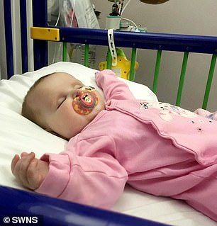Phoebe was diagnosed after a chest infection at Christmas wouldn't go away. Pictured in hospital having chemotherapy