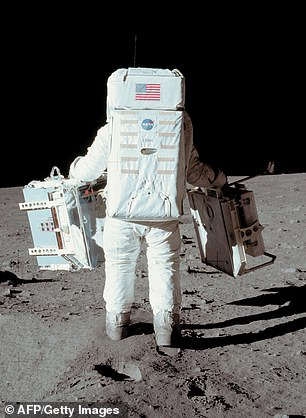 Buzz Aldrin is shown walking on the moon in a photo taken by Neil Armstrong