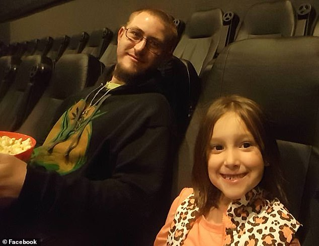 Earlier this month, he started experiencing stomach pains and breathing issues so he went the hospital. Pictured: Sean, left, with his daughter
