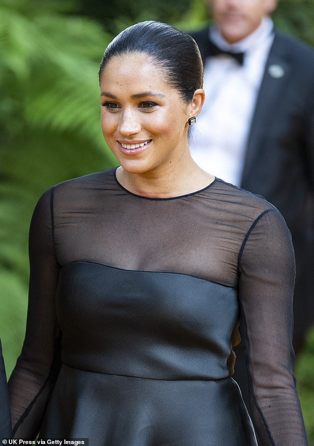 Megan Markle's dreams of a home delivery were dashed when she was whisked to a London hospital a week overdue in May. She is pictured atThe Lion King premiere in London on July 14