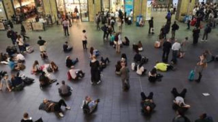 People waiting inside King's Cross station