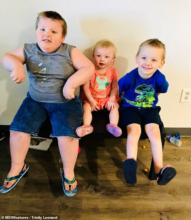 Peter is pictured with his siblings Candyce and Logan. Logan, right, is only a year younger than Peter put only about a quarter of his body weight