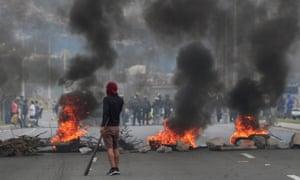 Across Quito, hooded men used rocks and burning tires to block streets in residential neighbourhoods.