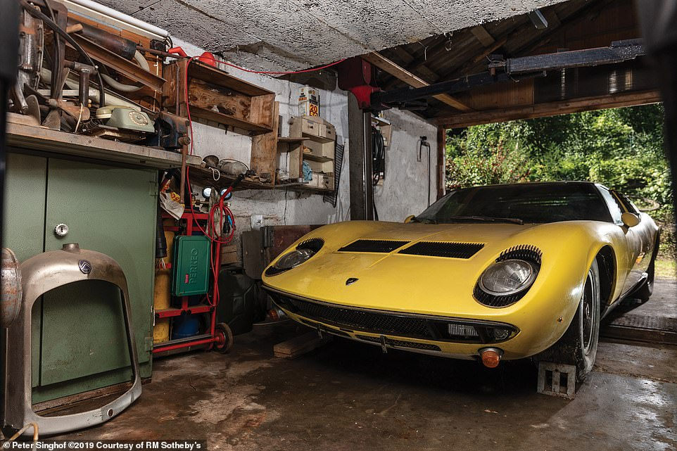 The £1.2million barn-find supercar: This 1969 Lamborghini Miura sold at a London car auction for a huge fee as bidders battled it out for what is believed to be one of the least modified examples of the original supercar