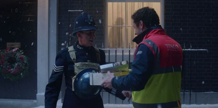 As part of the advert, the Tesco workers brings Christmas cheer to Winston Churcill at 10 Downing Street