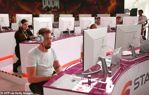 After public criticism of the lineup, Google vice president Phil Harrison announced additions to the platform, which include Wolfenstein: Youngblood and Rage 2. Pictured, gamers at Gamescom in August test out the Stadia platform, playing Doom, which is expected to be released on the commercial version of Stadia early next year
