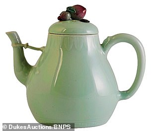 This 18th-century china teapot has just been sold at auction for £1million and has a blue seal mark of Chinese emperor Qianlong