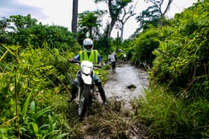 An MSF team on motorbikes in the middle of the bush trying to reach the Lungonzo area to deliver vaccines.