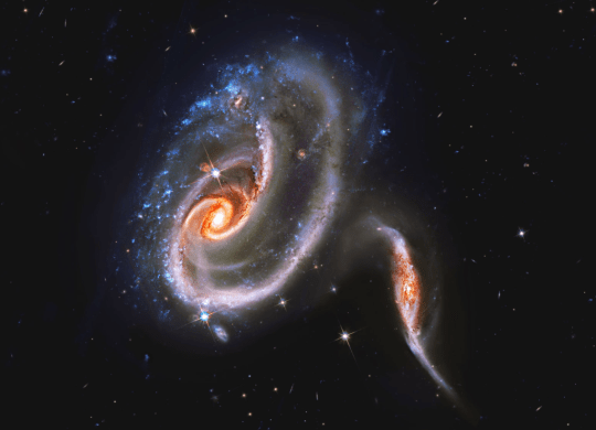 This pair of galaxies are locked in cosmic combat (Image: Nasa)