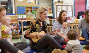 Mothers sing with their babies.