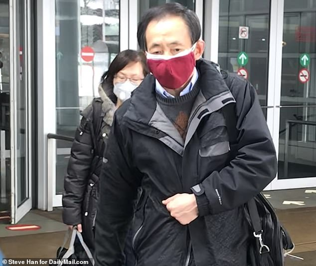 According to the Centers for Disease Control and Prevention, the woman traveled to Wuhan in late December and arrived back in the US on January 13. Pictured:Passengers wearing masks arrive at O'Hare International Airport, Thursday