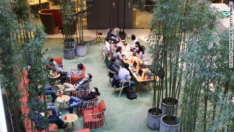 """Workers at a co-working space in Beijing in 2018. China surpassed the United States last year to become the world's top hub for """"unicorns,"""" or private billion-dollar startups, according to a research firm."""
