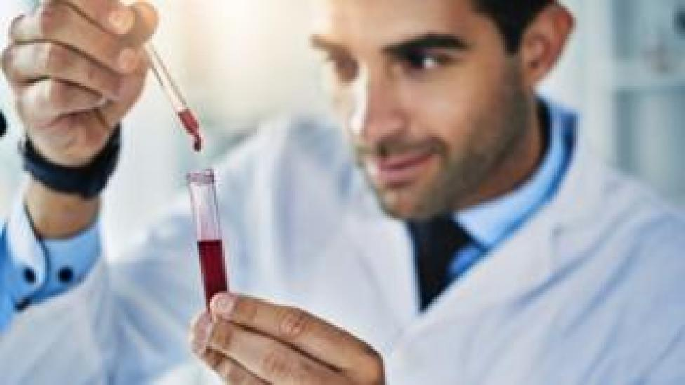 Lab worker testing a blood sample