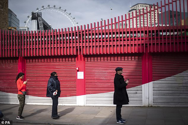 Customers observing social distancing in the queue for a supermarket in Westminster, London as the UK continues in lockdown to help curb the spread of the coronavirus