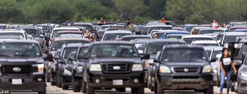 Cars began lining up in the parking lot as early as Wednesday night after about 5,000 families pre-registered for the event