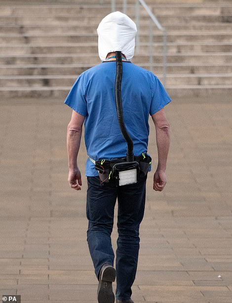 It connects to a small portable unit that straps around the wearer's waist that supplies clean, filtered air
