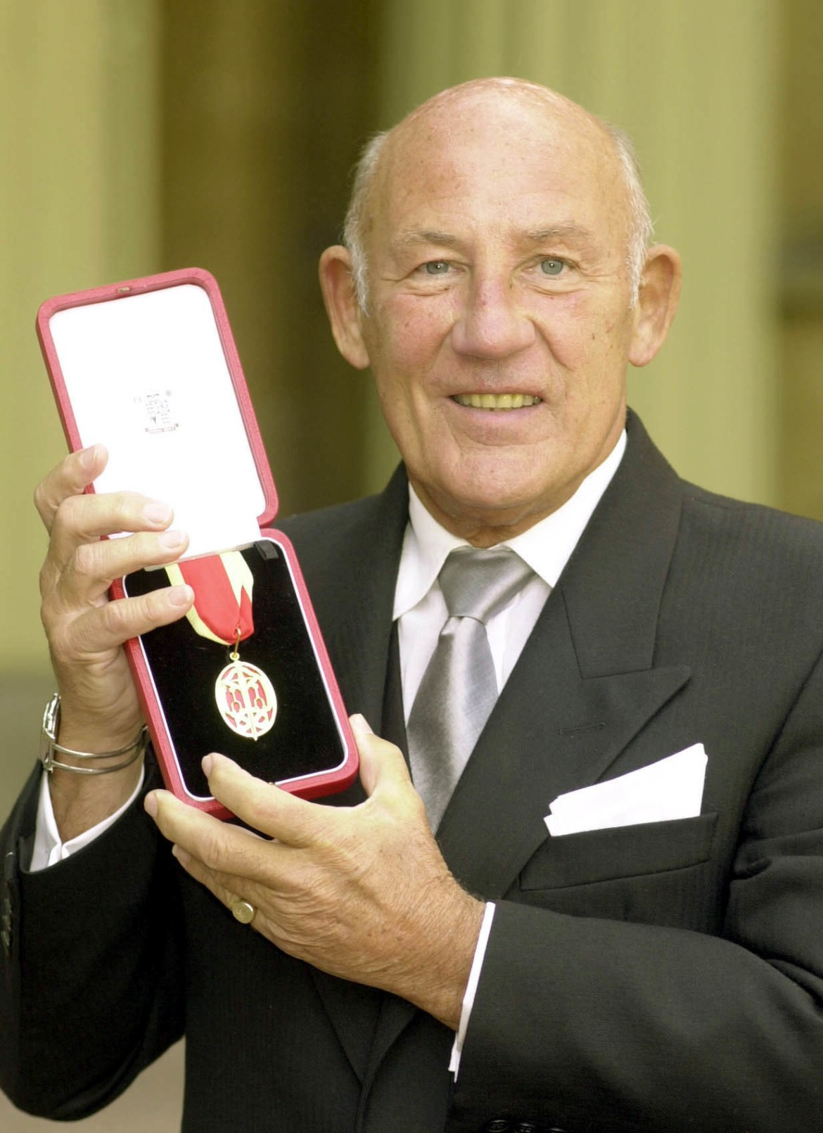 His career was cut short after a crash at Goodwood in 1962 but he was knighted 38 years later